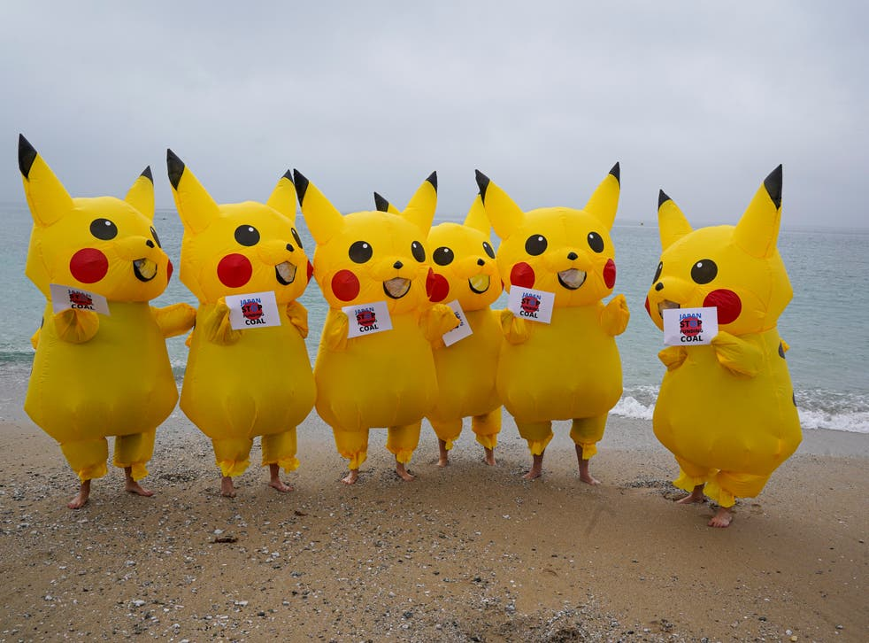 <p>Protesters dressed as Pikachu characters demonstrate on Gyllyngvase Beach, Falmouth</p>