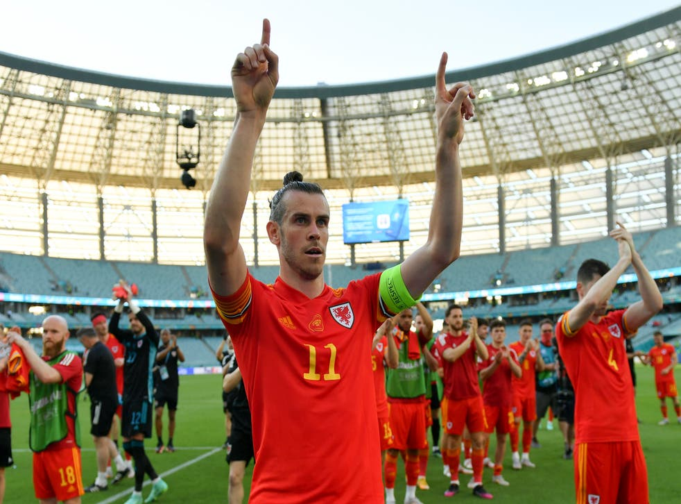Gareth Bale celebrates Wales' opening draw
