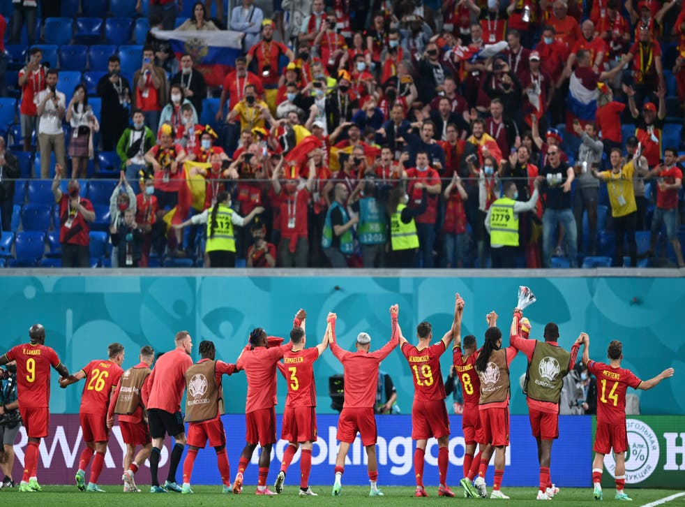 <p>Belgium's players celebrate with their fans after a 3-0 win over Russia</p>