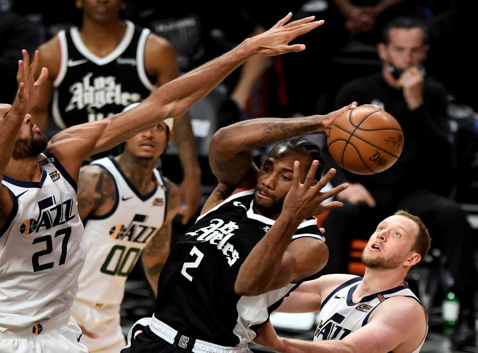 Los Angeles Clippers' Kawhi Leonard passes the ball as Utah Jazz's Rudy Gobert defends