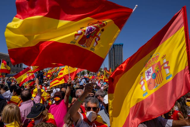 <p>Leaders of the centre to far-right opposition joined the protest at Madrid's Colon Square on Sunday</p>