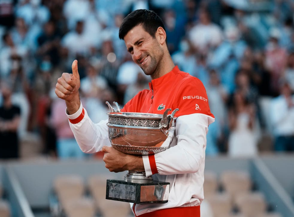 <p>Novak Djokovic gives a thumbs up as he holds the Coupe des Mousquetaires</p>