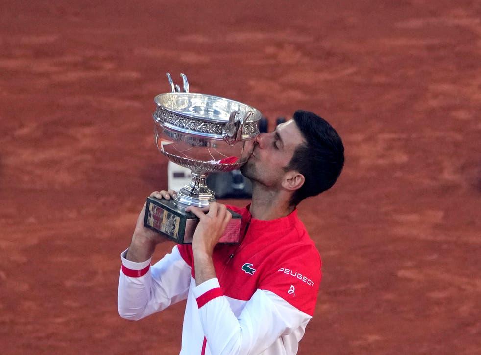 <p>Novak Djokovic kisses the Coupe des Mousquetaires after his victory in Paris</p>