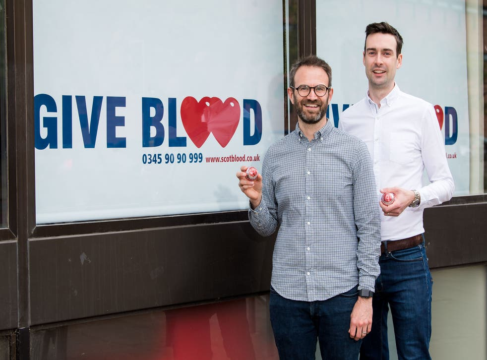 <p>Married couple Steven Smillie and Tyler McNeil mark the changes to blood donation rules at Edinburgh Donor Centre in Scotland</p>