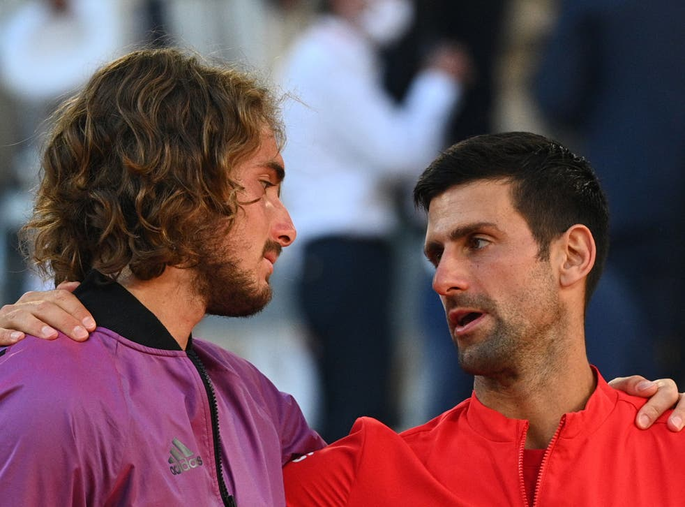 <p>Novak Djokovic (right) consoles Stefanos Tsitsipas after the French Open final</p>