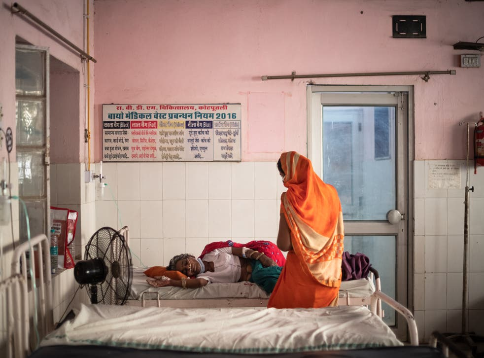 <p>A Covid patient is treated with oxygen at a hospital in Rajasthan, India</p>