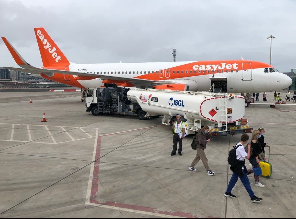 <p>Rare sight: an easyJet Airbus at Gibraltar airport, one of the very few locations from which you can travel without quarantine</p>