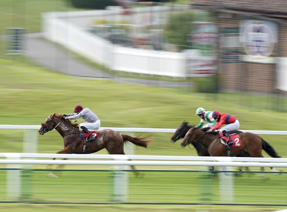 James Doyle riding Ebro River (left) coming home to win The Coral 'Beaten By A Length' National Stakes at Sandown Park Racecourse