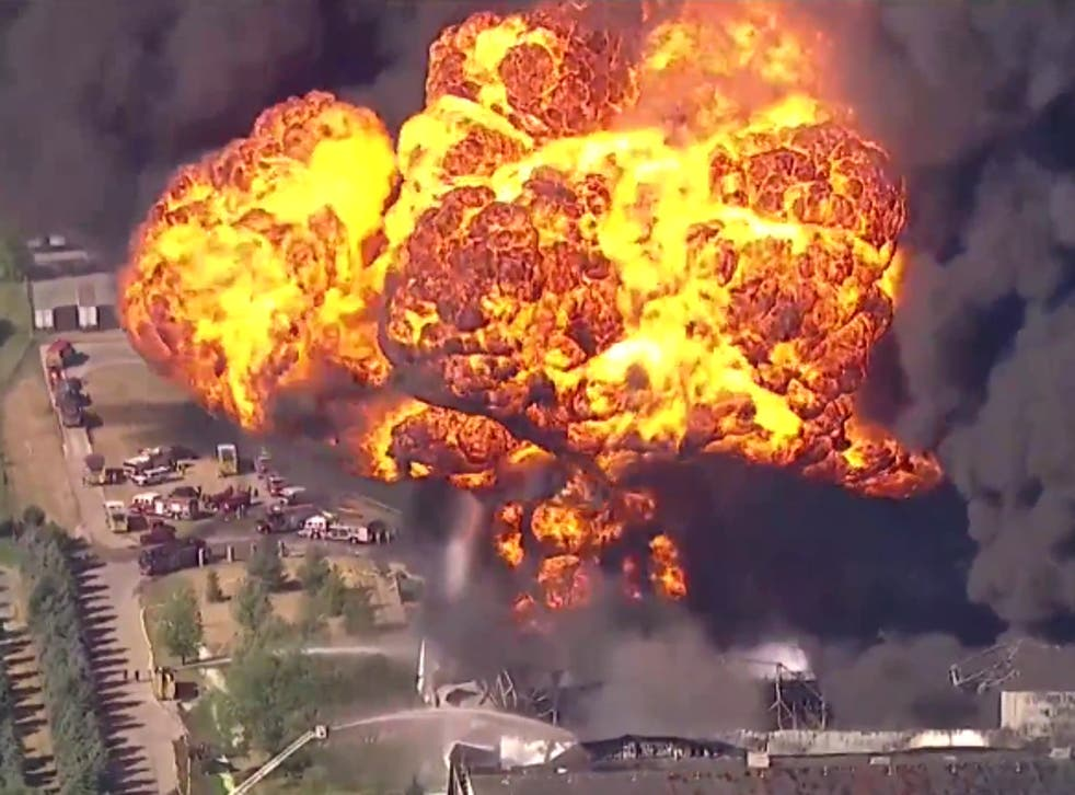 <p>A fireball explodes out from a Chemtool plant in Rockton, Illinois, as firefighters battle the blaze</p>