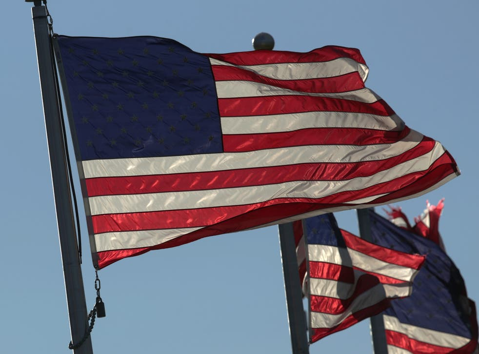 <p>US flags fly on the ground of the Washington Monument on Flag Day 14 June 2019 in Washington, DC</p>
