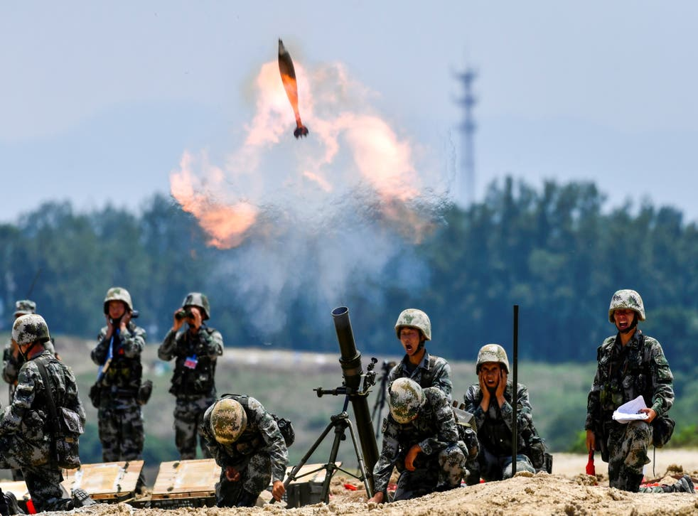 <p>Soldiers of the Chinese People's Liberation Army fire a mortar during a live-fire military exercise last month</p>