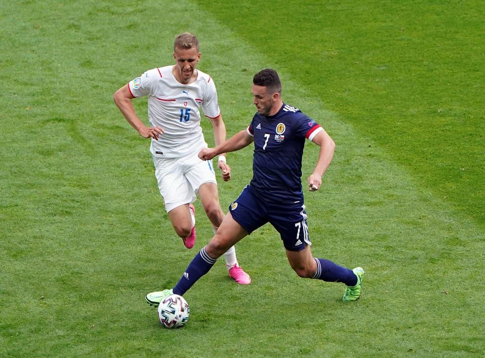 Scotland's John McGinn battles with the Czech Republic's Tomas Soucek