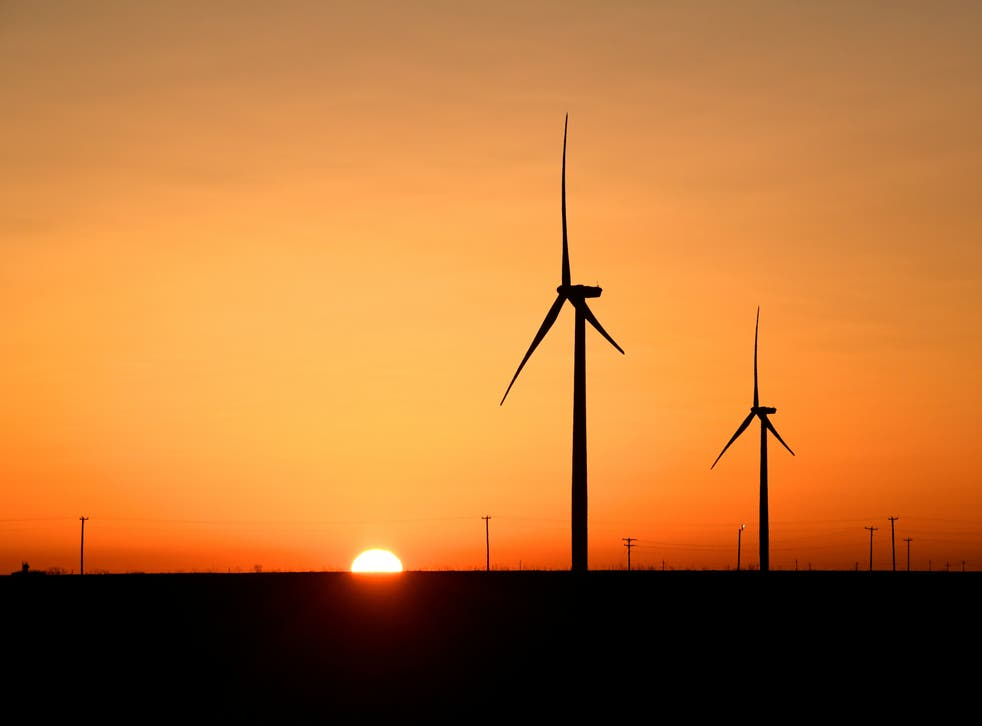 <p>Wind turbines operate at sunrise in the Permian Basin oil and natural gas production area in Big Spring, Texas, 12 February, 2019. REUTERS/Nick Oxford</p>