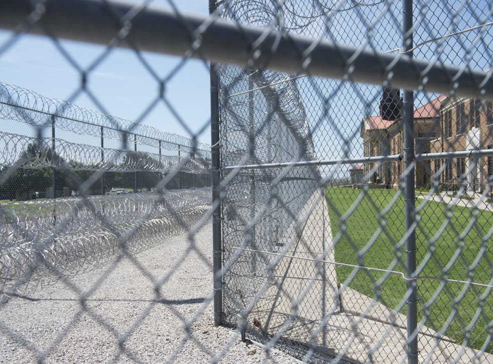 <p>Fences and barbed wire at the entrance of the El Reno Federal Correctional Institution in El Reno, Oklahoma, 16 July, 2015.</p>