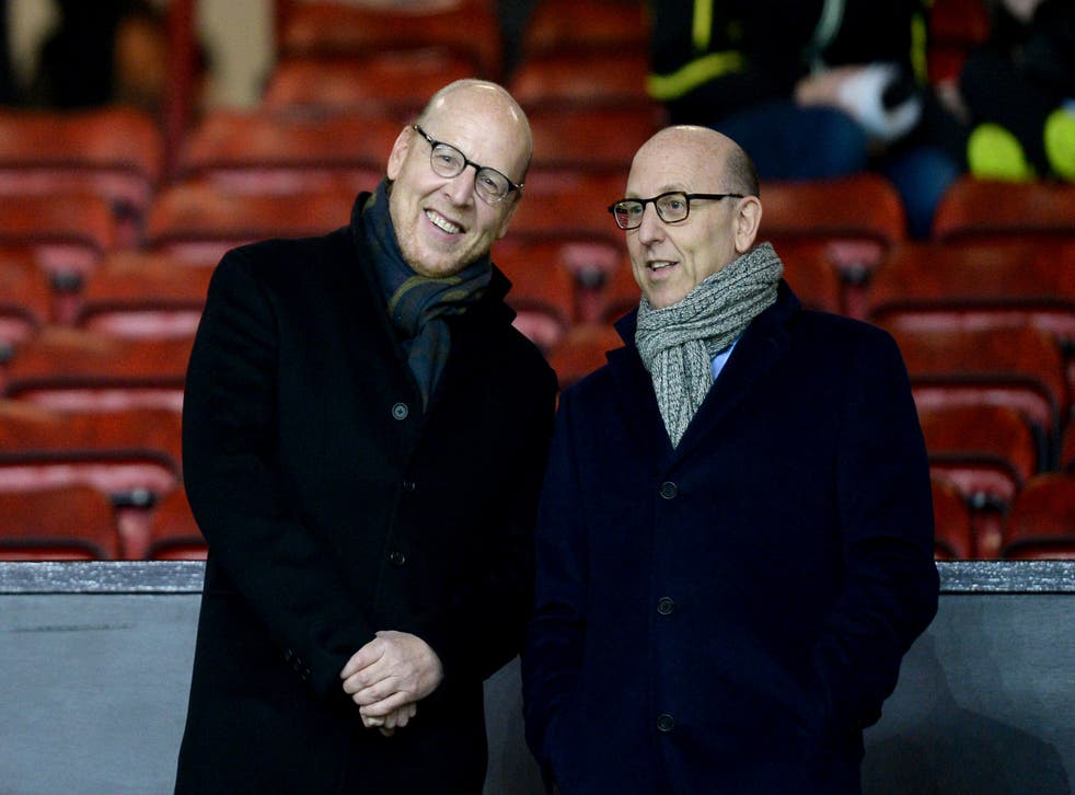 Joel Glazer (right) admits Manchester United's owners need to engage more with fans