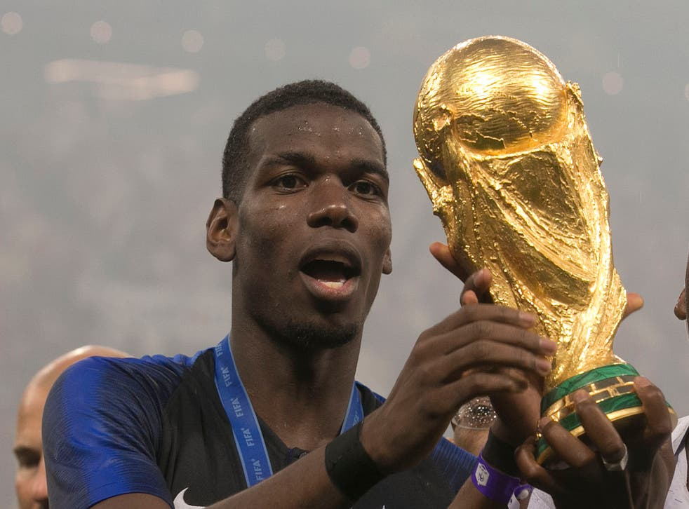 Paul Pogba celebrates with the World Cup trophy
