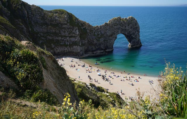 <p>Dorset Police said the woman, who has not been identified, was pronounced dead at the scene (pictured: Durdle Door in early June)</p>