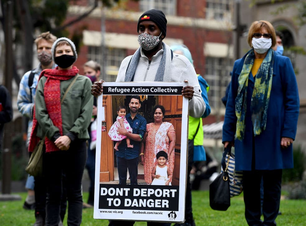 <p>People hold up placards at a rally to support the Sir Lankan origin Tamil family living in detention </p>