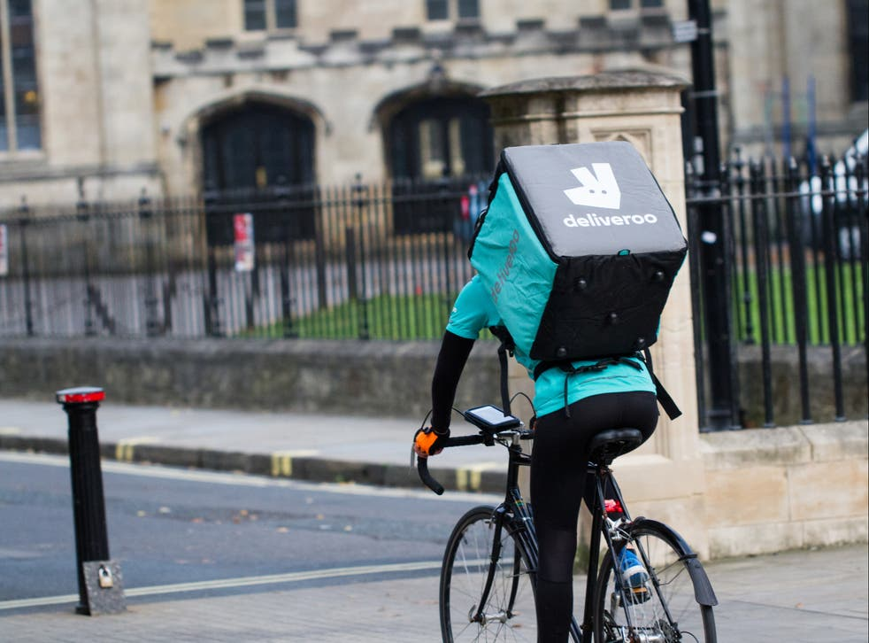 <p>A Deliveroo rider on a bicycle</p>