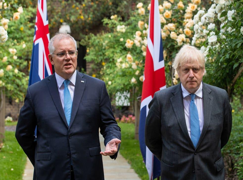 <p>Boris Johnson looks on as Australia's Prime Minister Scott Morrison speaks at No 10 on Tuesday</p>