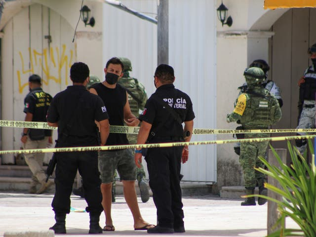 <p>Police officers and soldiers are pictured during an operation one day after the murder of two men and where a tourist was injured during the shooting at Tortugas beach in Cancun, Mexico June 12, 2021. </p>