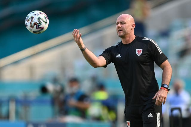 <p>Wales caretaker manager Robert Page on the touchline</p>