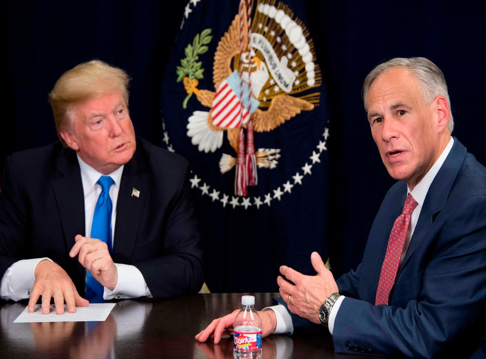 <p>Texas Governor Greg Abbott (right) speaks with then-US President Donald Trump (left) during a briefing on hurricane relief efforts in Dallas, Texas, on 25 October, 2017. Mr Abbott has said he plans to raise funds to build more border wall between the US and Mexico.</p>
