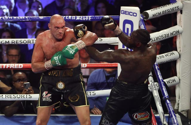 <p>Tyson Fury (left) and Deontay Wilder during their WBC world heavyweight title bout in Las Vegas</p>