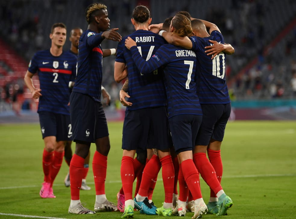 French players celebrate after scoring their side's first goal during the Euro 2020 Group F match against France and Germany in Munich