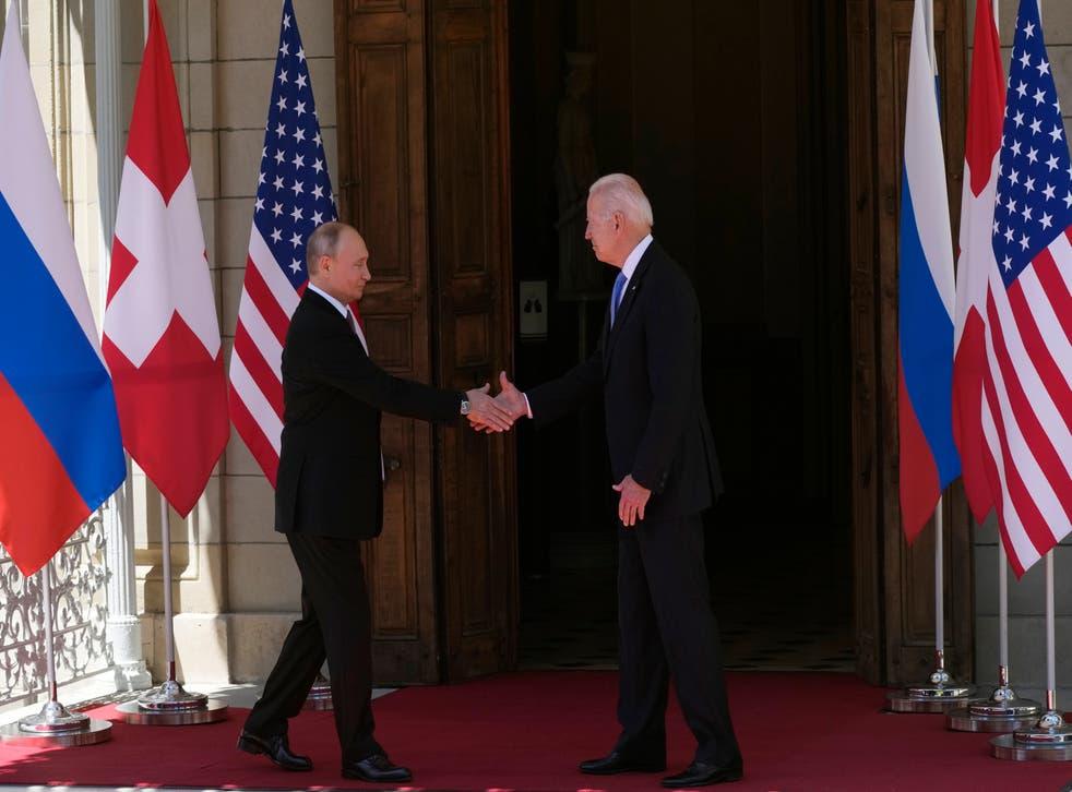 <p>Russian President Vladimir Putin, left, and U.S President Joe Biden shake hands during their meeting at the 'Villa la Grange' in Geneva on June 16</p>