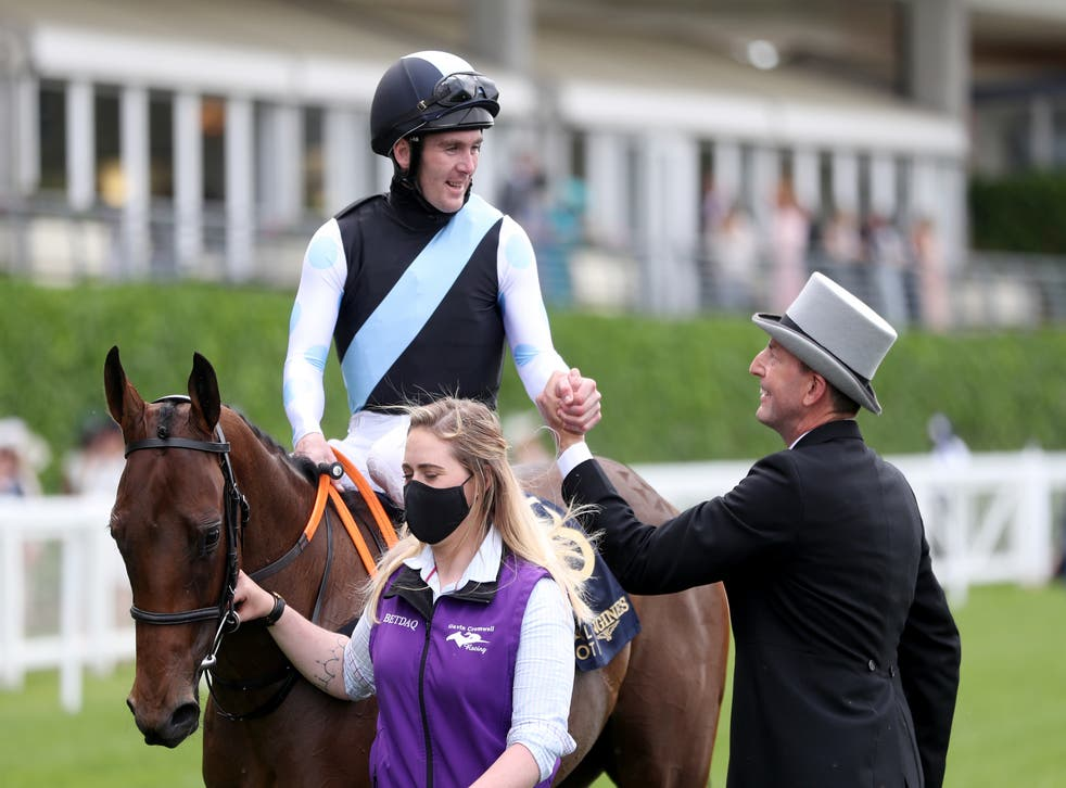 Jockey Gary Carroll and trainer Gavin Cromwell celebrate after Quick Suzy's victory in the Queen Mary Stakes at Royal Ascot