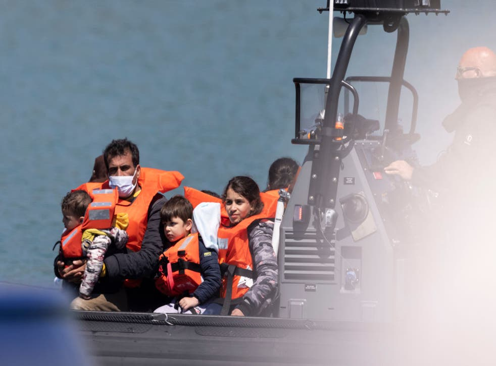 <p>Border Force officials guide newly arrived migrants into port after being picked up in a dinghy in the English Channel on 9 June, 2021</p>