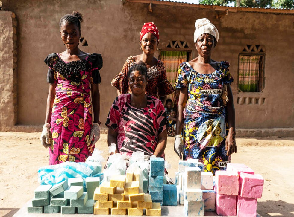 <p>Germaine, centre, with her soap-making team</p>