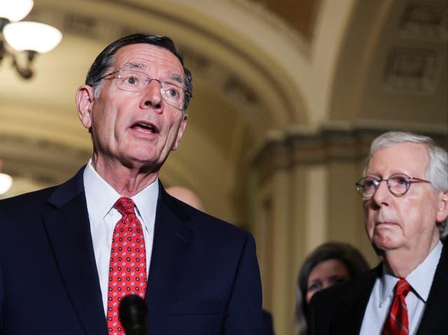 <p>US Senator John Barrasso is flanked by Senate Minority Leader Mitch McConnell </p>