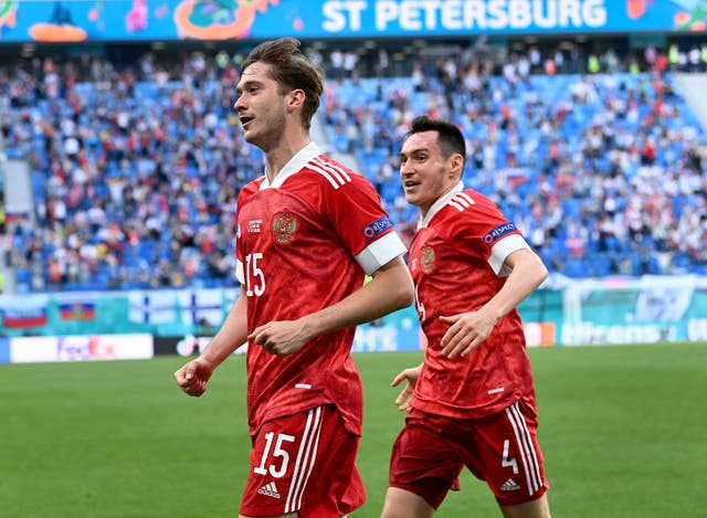 Russia's Aleksei Miranchuk, front, celebrates after scoring the winner against Finland