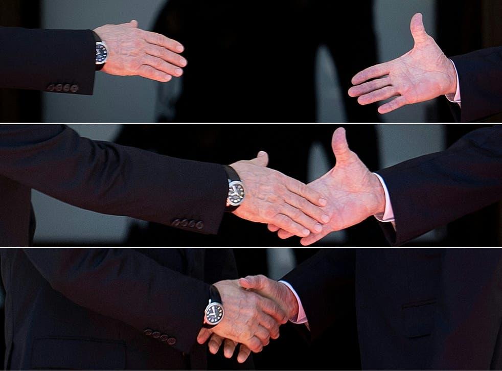 <p>Russia's president Vladimir Putin (left) and US president Joe Biden reaching out to shake hands before their meeting at Villa La Grange, Geneva</p>