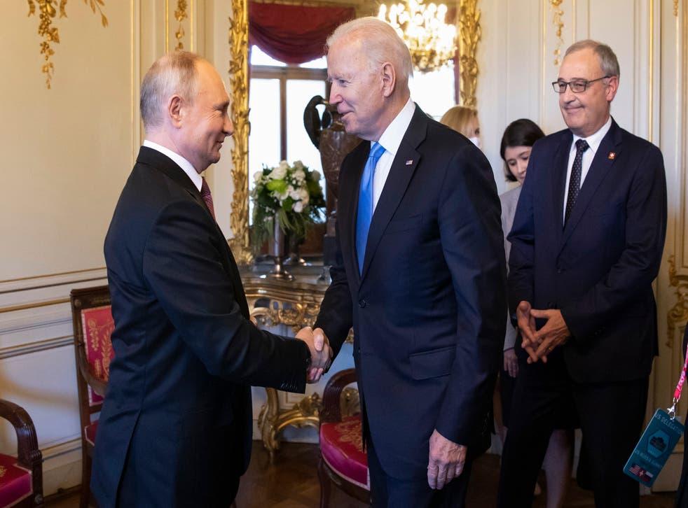 <p>Vladimir Putin shakes hands with Joe Biden during their  summit in Geneva</p>