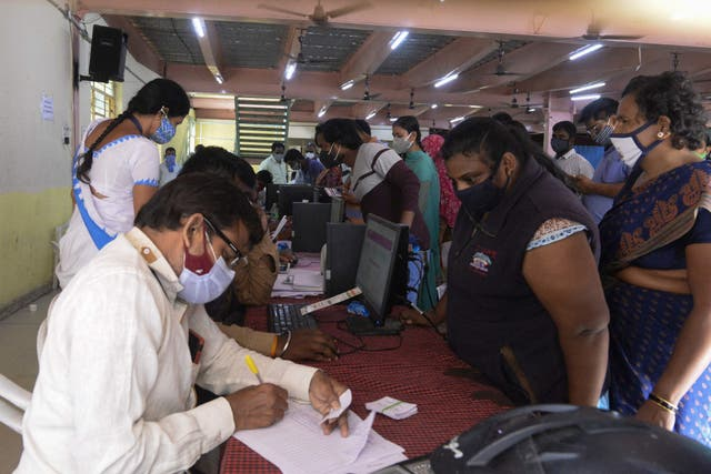 <p>People lineup to register to receive a dose of a Covid-19 vaccine during an inoculation drive in Hyderabad, India, on 16 June, 2021. The first case of 'green fungus' has been found in a Covid-19 recovered patient in Madhya Pradesh</p>