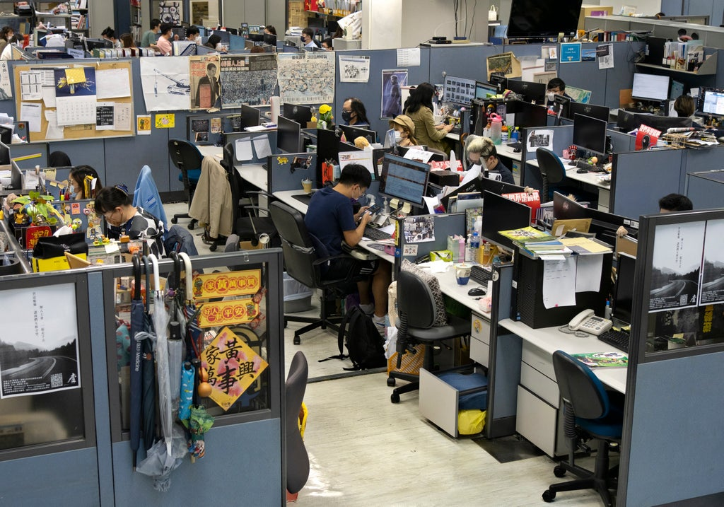 Apple Daily: Hong Kong police arrest five and seize assets in raid on pro-democracy newspaper