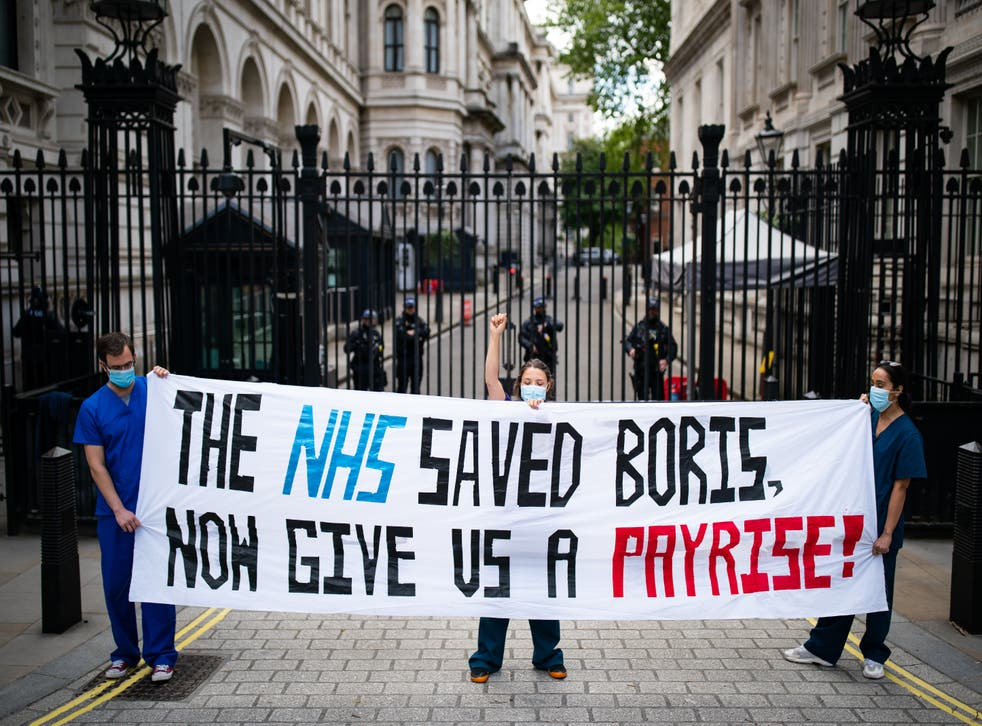 Nurses protesting outside Downing Street last May (Aaron Chown/PA)