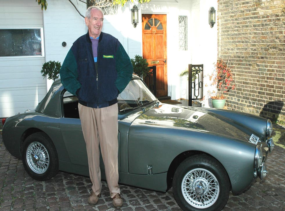 <p>Sprinzel, pictured with his most famous car</p>