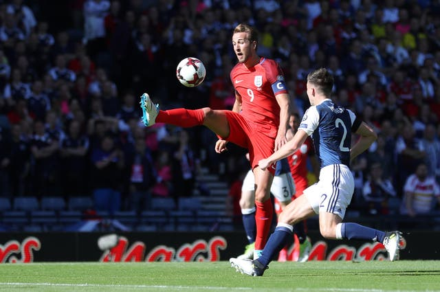 <p>England's Harry Kane (left) and Scotland's Kieran Tierney battle for the ball in 2017</p>