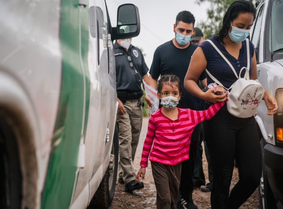 <p>An immigrant family seeking asylum prepare to be taken to a border patrol processing facility after crossing into the US on 16 June, 2021 in La Joya, Texas. US Attorney General Merrick Garland has reversed two Trump-era asylum decisions.</p>