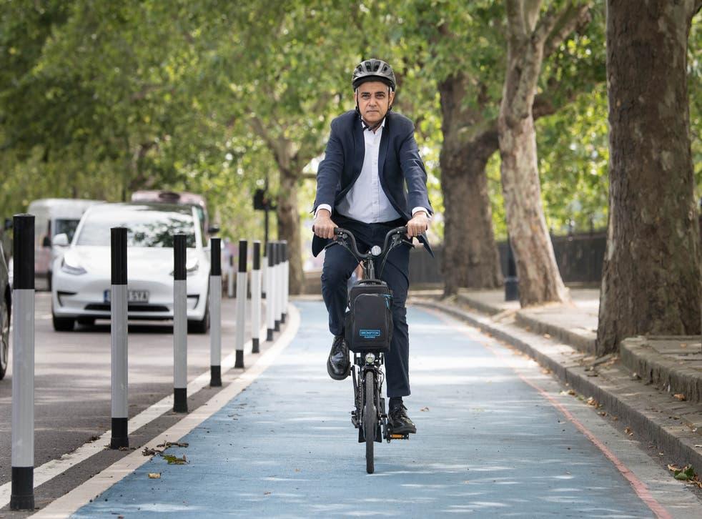 <p>Mayor of London Sadiq Khan cycles down a new Streetspace bike lane in London on 23 July 2020 </p>