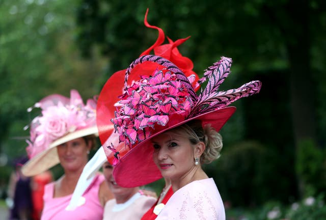 A racegoer arrives ahead of day three of Royal Ascot at Ascot Racecourse