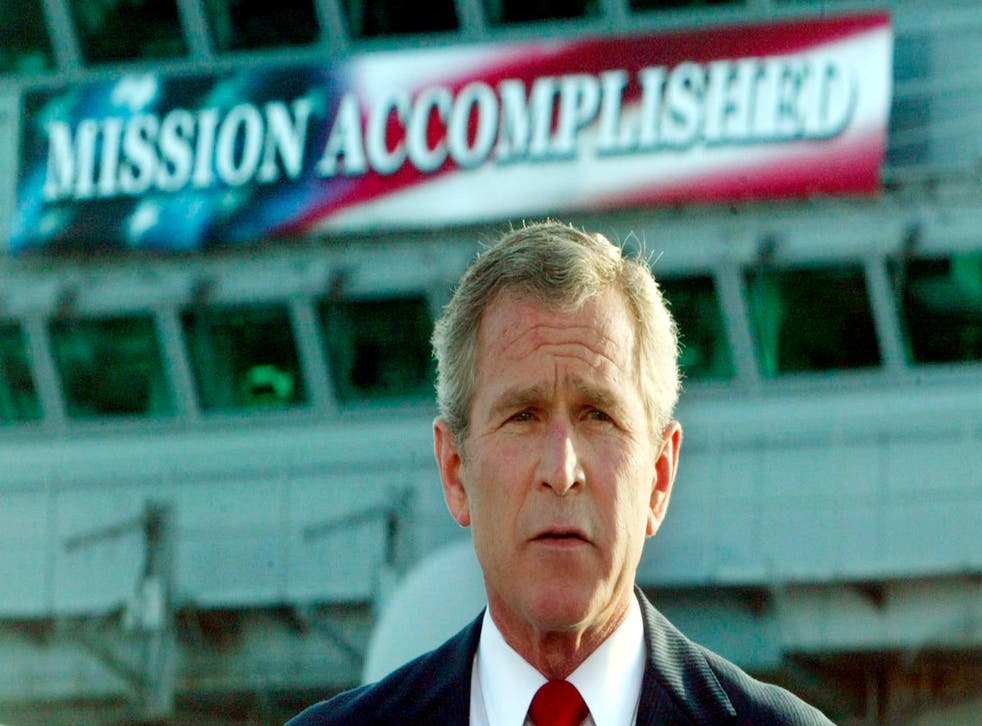 <p>George W Bush declares combat in Iraq over aboard aircraft carrier USS Abraham Lincoln in 2003</p>