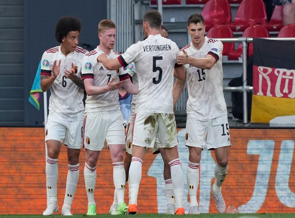 Kevin De Bruyne (second left) celebrates after firing Belgium to victory over Denmark