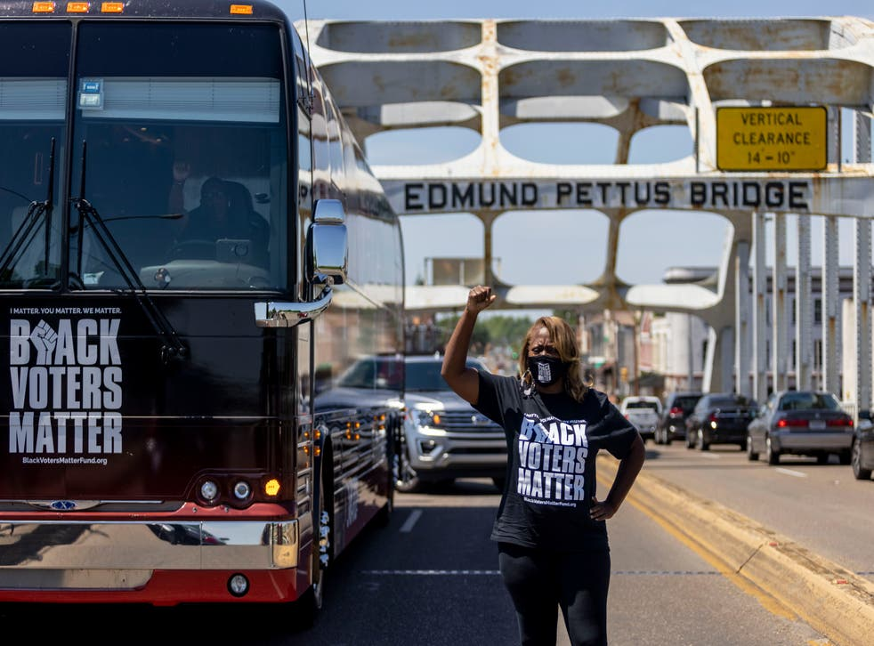 <p>Black Voters Matter co-founder LaTosha Brown stands on the Edmund Pettus Bridge in Selma, Alabama, nearly 60 years after critical voting rights marches.</p>