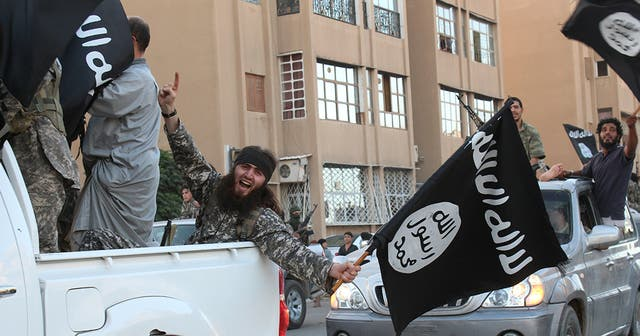 <p>Isis parading in the northern Syrian city of Raqa in 2014</p>