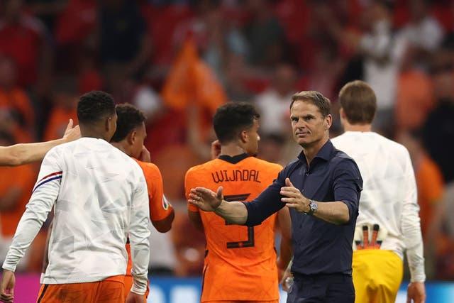 <p>Frank De Boer applauds his players</p>